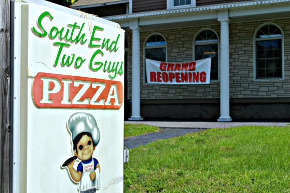 The sign outside South End Two Guys Pizza on 277 South Main St. in Torrington, which had its grand reopening Wednesday, August 21st. - © Tabitha Guarnieri